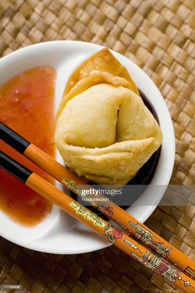 A deep-fried wonton with two sauces (close-up) : Stock Photo