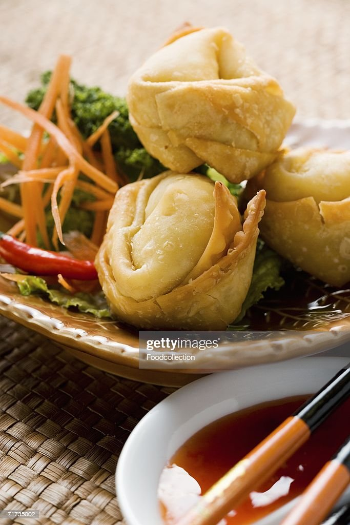 Deep-fried wontons with salad and two sauces : Stock Photo