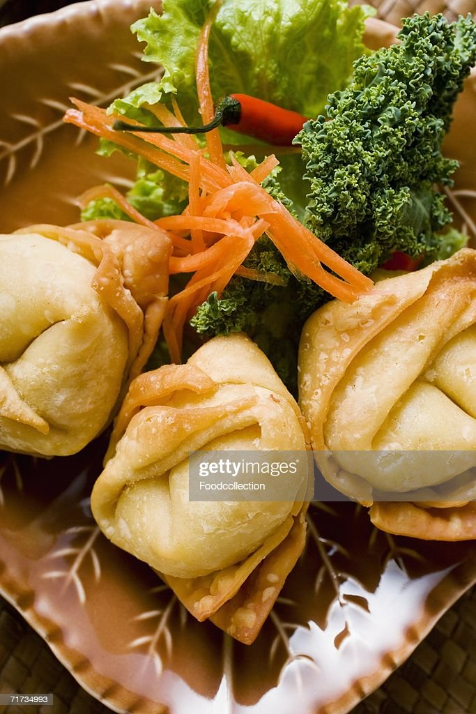 Deep-fried wontons with salad : Stock Photo