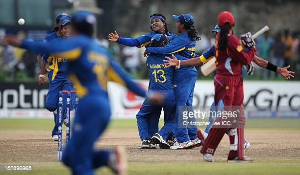 Deepika Rasangika Eshani Lokusooriya and Shashikala Siriwardena of Sri Lanka celebrate their victory as Anisa Mohammed of West Indies watches during...
