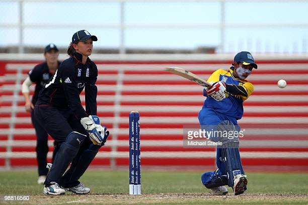 Deepika Rasangika of Sri Lanka pulls to the legside as Sarah Taylor of England looks on during the ICC T20 Women's World Cup warm up match between...