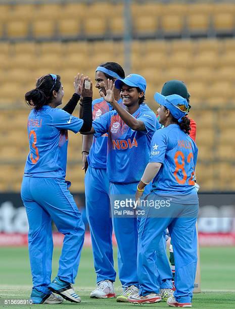 Deepti Sharma of India and Shikha Pandey of India celebrate the wicket of Sharmin Akter Supta of Bangladesh during the Women's ICC World Twenty20...