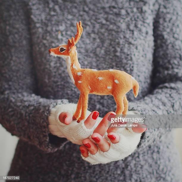 A deer in her hands