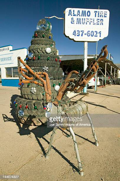 Deer made out of mufflers stack of tires at Alamo Tires Muffler in Alamogordo southern New Mexico off route 54
