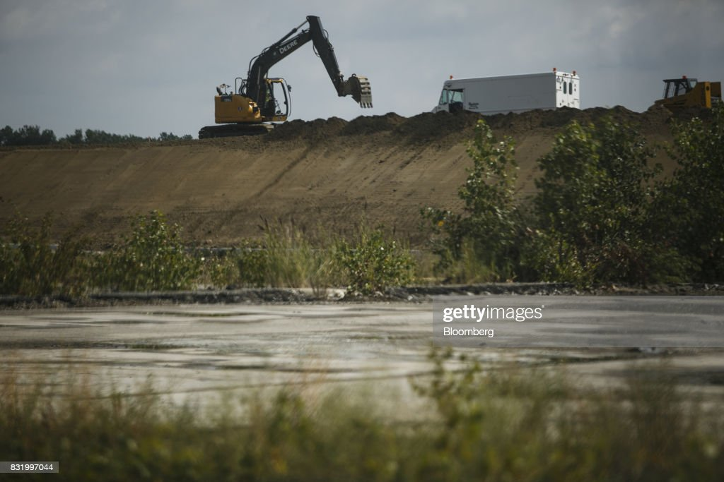 A Deere & Co. excavator move dirt on the construction site of the American Mobility Center (ACM) in Ypsilanti, Michigan, U.S., on Tuesday, Aug. 15, 2017. Representative Debbie Dingel, a Democrat from Michigan, and Representative Bob Latta, a Republican from Ohio, visited the ACM to meet with experts in the autonomous vehicles industry as the two work together to advance bipartisan self-driving vehicle legislation through the House floor. Photographer: Sean Proctor/Bloomberg via Getty Images