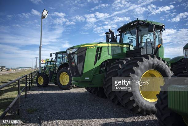 A Deere Co John Deere 9510 R tractor sits on display at a United Ag Turf dealership in Waco Texas US on Monday Nov 20 2017 Deere Co is scheduled to...