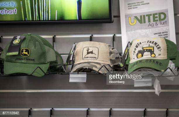 Deere Co John Deere branded hats sit on display at a United Ag Turf dealership in Waco Texas US on Monday Nov 20 2017 Deere Co is scheduled to...