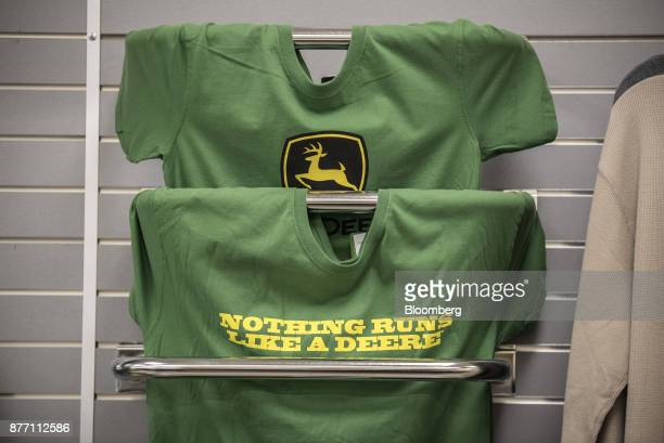 Deere Co John Deere branded tshirts hang on display at a United Ag Turf dealership in Waco Texas US on Monday Nov 20 2017 Deere Co is scheduled to...