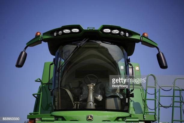 A Deere Co John Deere combine harvester sits on display for sale at the Smith Implements Inc dealership in Greensburg Indiana US on Wednesday Aug 16...