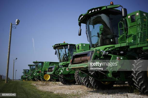 Deere Co John Deere combine harvesters sit on display for sale at the Smith Implements Inc dealership in Greensburg Indiana US on Wednesday Aug 16...