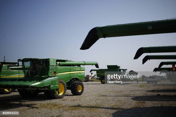 Deere Co John Deere combine harvesters sit parked at the Smith Implements Inc dealership in Greensburg Indiana US on Wednesday Aug 16 2017 Deere Co...