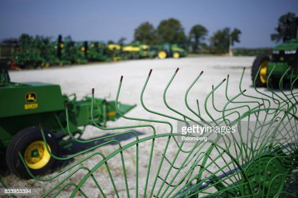 Deere Co John Deere farm machinery sit on display for sale at the Smith Implements Inc dealership in Greensburg Indiana US on Wednesday Aug 16 2017...