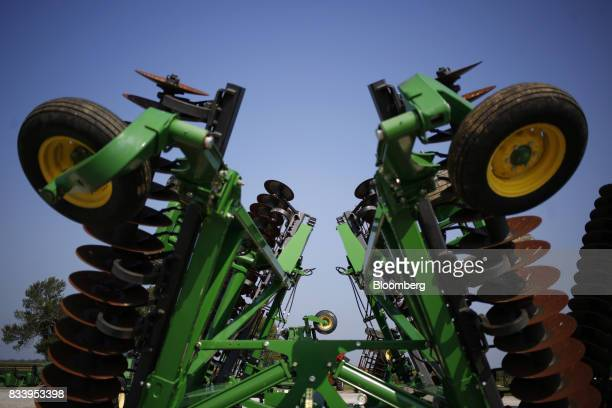 Deere Co John Deere farm machinery sits on display for sale at the Smith Implements Inc dealership in Greensburg Indiana US on Wednesday Aug 16 2017...