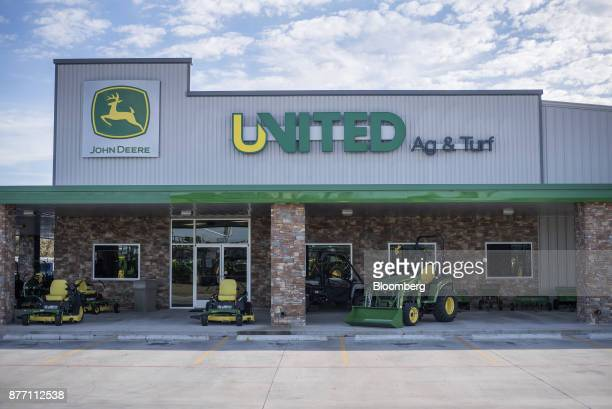 Deere Co John Deere lawn mowers and tractors sit on display at a United Ag Turf dealership in Waco Texas US on Monday Nov 20 2017 Deere Co is...