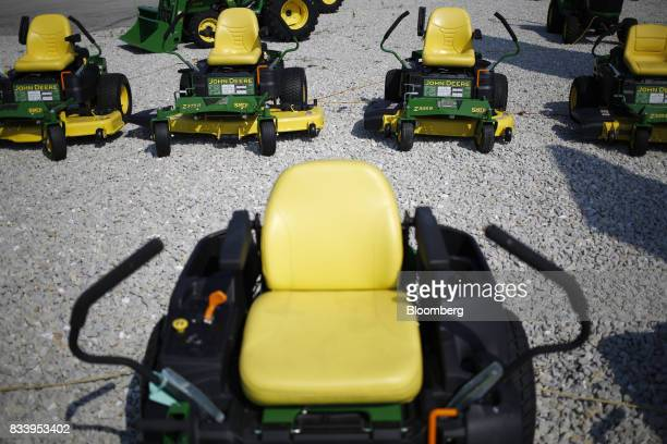 Deere Co John Deere riding movers sit on display for sale at the Smith Implements Inc dealership in Greensburg Indiana US on Wednesday Aug 16 2017...