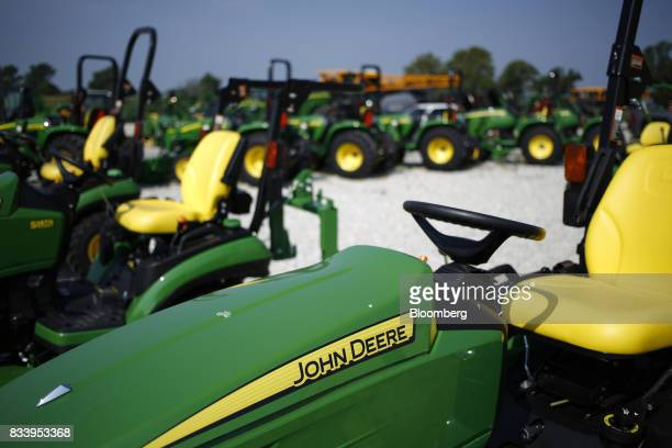 Deere Co John Deere signage is displayed on a riding mover at the Smith Implements Inc dealership in Greensburg Indiana US on Wednesday Aug 16 2017...