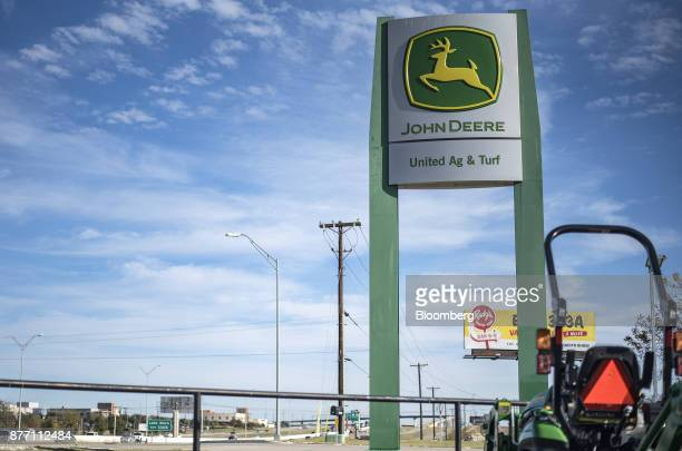 Deere Co John Deere signage stands at a United Ag Turf dealership in Waco Texas US on Monday Nov 20 2017 Deere Co is scheduled to release earnings...