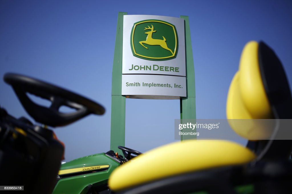 Deere & Co. John Deere signage stands at the Smith Implements Inc. dealership in Greensburg, Indiana, U.S., on Wednesday, Aug. 16, 2017. Deere & Co. is scheduled to release earnings figures on August 18. Photographer: Luke Sharrett/Bloomberg via Getty Images