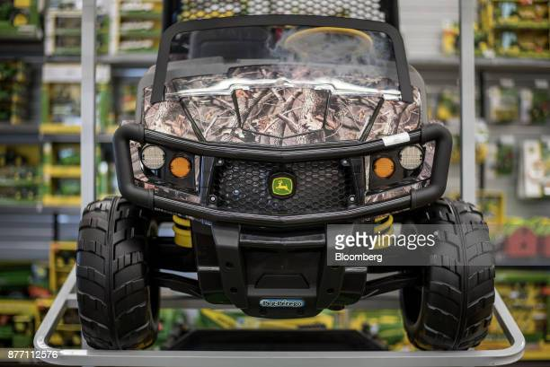 A Deere Co John Deere toy electric car sits on a display at a United Ag Turf dealership in Waco Texas US on Monday Nov 20 2017 Deere Co is scheduled...