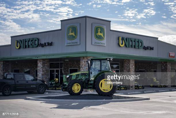 A Deere Co John Deere tractor sits on display at a United Ag Turf dealership in Waco Texas US on Monday Nov 20 2017 Deere Co is scheduled to release...