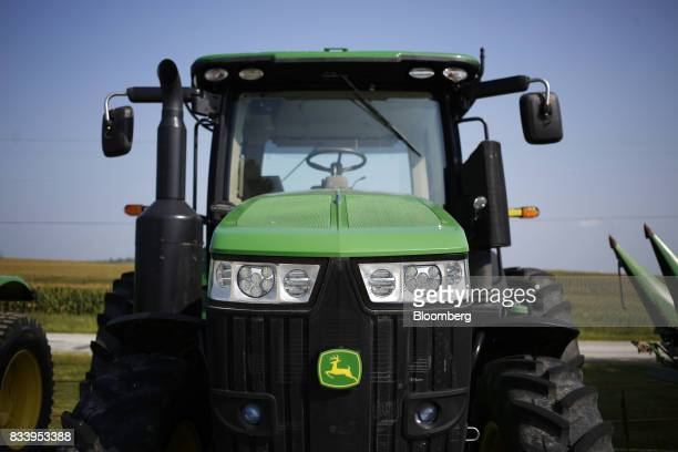A Deere Co John Deere tractor sits on display for sale at the Smith Implements Inc dealership in Greensburg Indiana US on Wednesday Aug 16 2017 Deere...