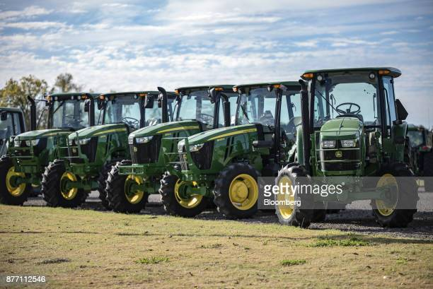 Deere Co John Deere tractors sit on display at a United Ag Turf dealership in Waco Texas US on Monday Nov 20 2017 Deere Co is scheduled to release...