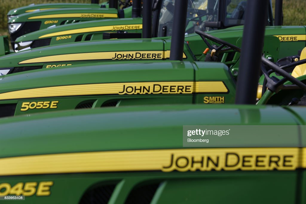 Deere & Co. John Deere tractors sit on display for sale at the Smith Implements Inc. dealership in Greensburg, Indiana, U.S., on Wednesday, Aug. 16, 2017. Deere & Co. is scheduled to release earnings figures on August 18. Photographer: Luke Sharrett/Bloomberg via Getty Images