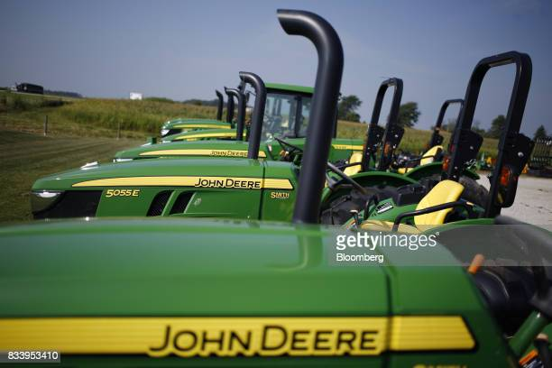 Deere Co John Deere tractors sit on display for sale at the Smith Implements Inc dealership in Greensburg Indiana US on Wednesday Aug 16 2017 Deere...