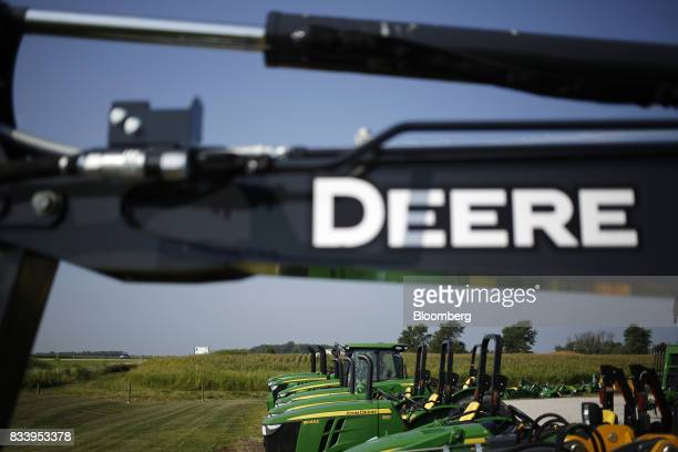 Deere Co signage is displayed on a construction machine at the Smith Implements Inc dealership in Greensburg Indiana US on Wednesday Aug 16 2017...