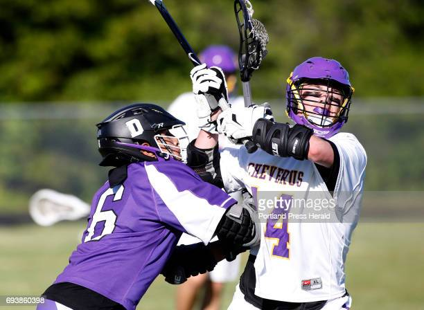 Deering junior Omar Contreras at left and Cheverus junior Finn Cawley fight for control of the ball during their quarterfinal game at Cheverus High...