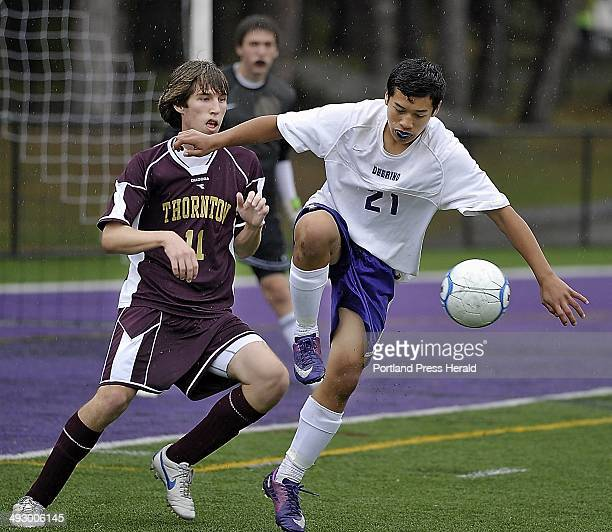 Deering Matthew Alvarez keeps control of the ball in front of the Thornton goal as Thornton defender #11 Mitchell Dehetre guards the goal as Deering...