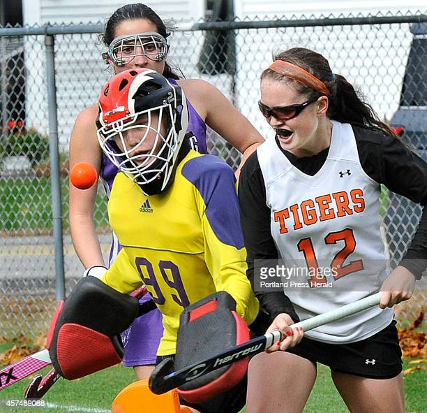 Deering's goal keeper Lillian Frager makes a save against Biddeford's Charlotte White with Deering's Katy Cyr in the background as Biddeford HS field...