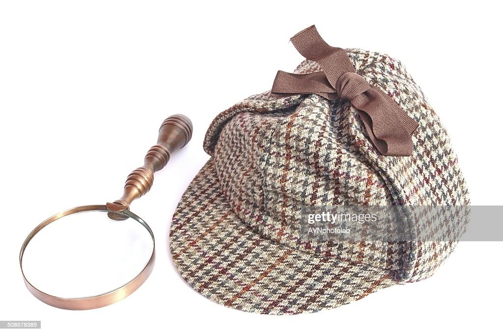 Deerstalker Cap and Vintage Magnifying Glass : Stock Photo