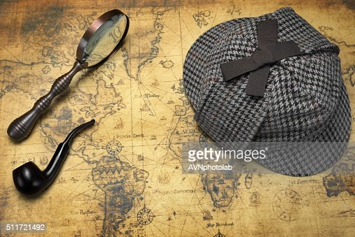 Deerstalker Hat, Magnifier And Smoking Pipe On Map : Stock Photo