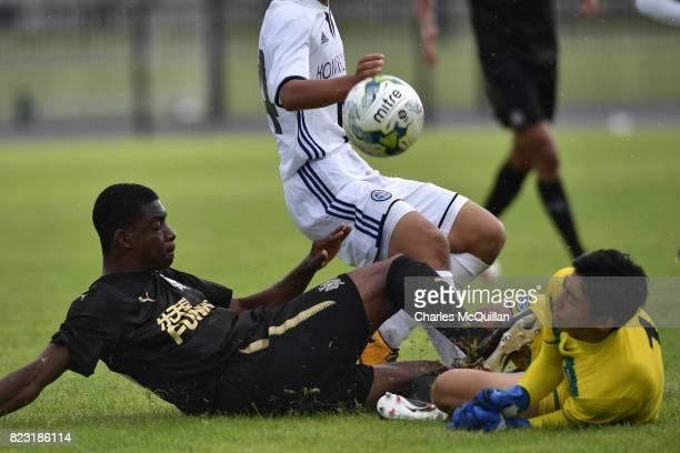 Deese Kasinga Madia of Newcastle United and Riki Toriyama of Komazawa University FC collide during the Super Cup NI u18 tournament group game between...