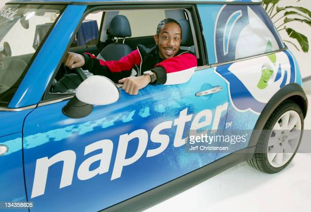 Def Jam recording artist Ludacris sits in the Napster car during a press event October 9 2003 in New York Napster a division of Roxio announced...