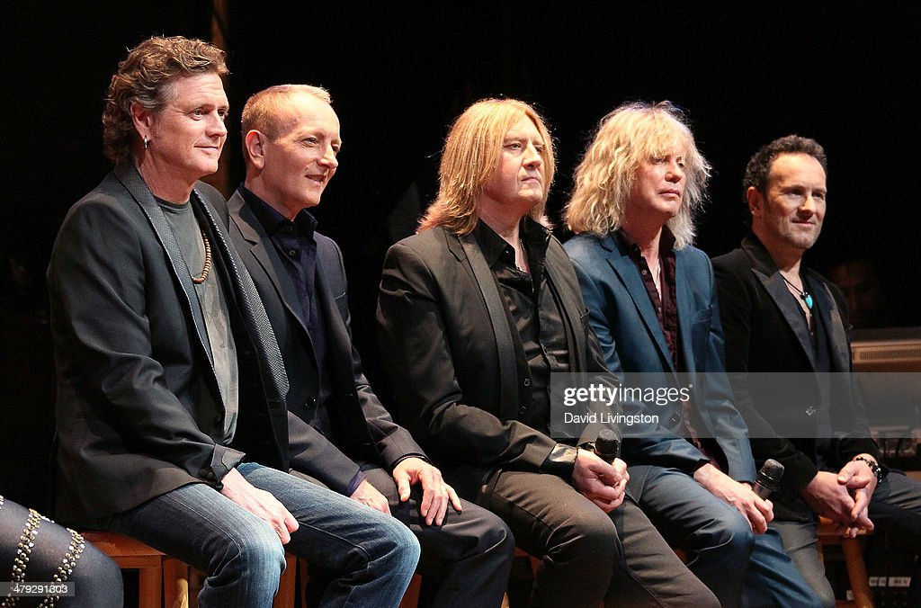 Def Leppard members Rick Allen, Phil Collen, Joe Elliot, Rick Savage and Vivian Campbell attend the KISS and Def Leppard press announcement at House of Blues on March 17, 2014 in Los Angeles, California.