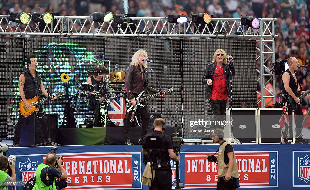 Def Leppard perform at the NFL football match between Oakland Raiders v Miami Dolphins at Wembley Stadium on September 28, 2014 in London, England.