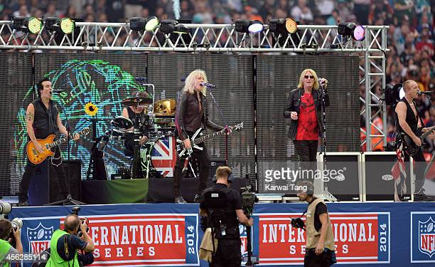 Def Leppard perform at the NFL football match between Oakland Raiders v Miami Dolphins at Wembley Stadium on September 28 2014 in London England
