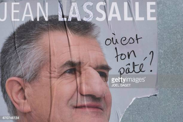 A defaced campaign poster of French lawmaker and independent candidate for French presidential election Jean Lassalle is pictured on April 19 2017 /...