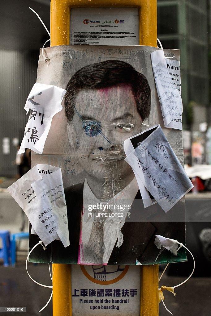 A defaced placard of Hong Kong Chief executive Leung Chunying is displayed near the Hong Kong government headquarters in Hong Kong on October 3 2014...