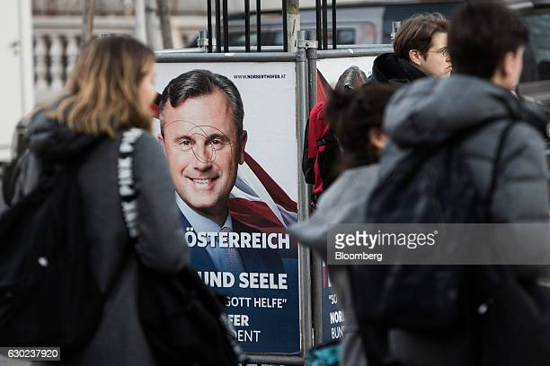 A defaced poster shows the face of Norbert Hofer presidential candidate of Austria's Freedom party on a sidewalk ahead of the 171st Organization of...