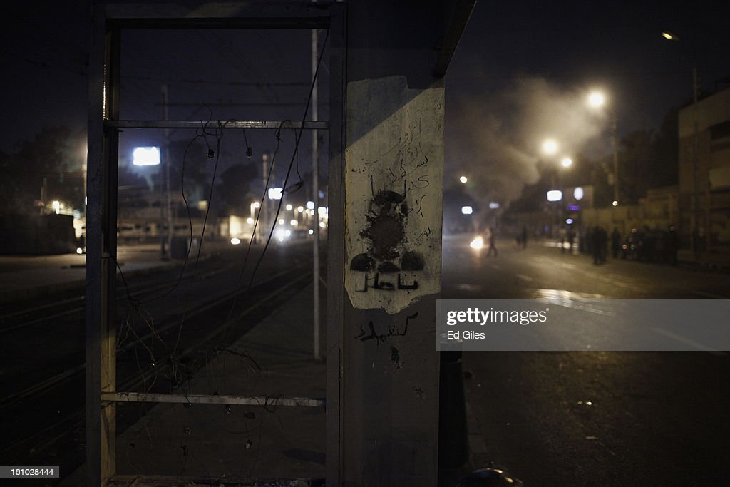 A defaced stencil of Egyptian President Mohammed Morsi is seen on the side of a damaged tram stop during violent protests at the Presidential Palace in Heliopolis on February 8, 2013, in Cairo, Egypt. Protests continued across Egypt against President Morsi and the Muslim Brotherhood two weeks after the second anniversary of the Egyptian Revolution that overthrew former President Hosni Mubarak on January 25, 2011.(Photo by Ed Giles/Getty Images).