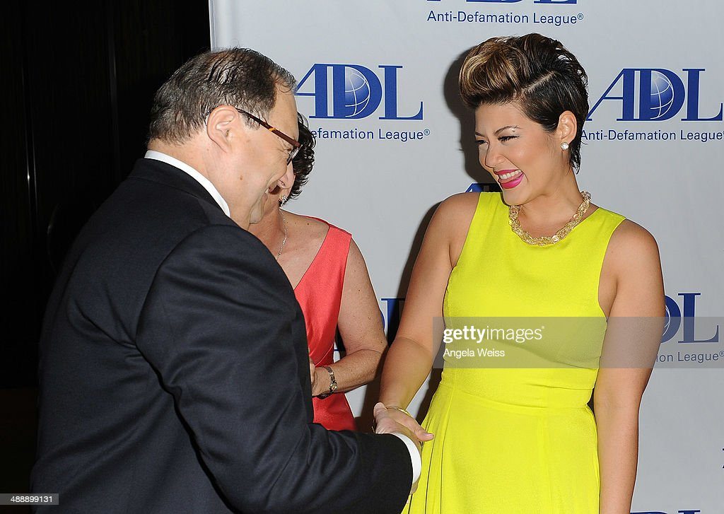 Defamation League National Director Abraham Foxman and singer Tessanne Chin arrive at the AntiDefamation League entertainment industry dinner...