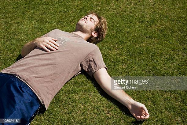 Defeated athlete lying on the grass