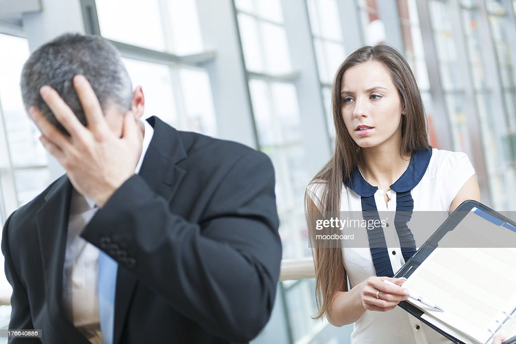 Defeated businessman turns away form coworker : Stock Photo
