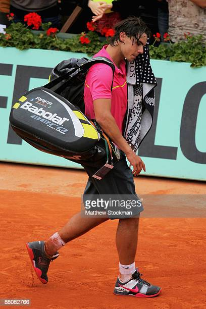 Defeated champion Rafael Nadal of Spain walks off court following his defeat during the Men's Singles Fourth Round match against Robin Soderling of...