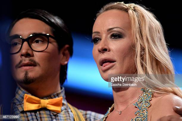 Defeated Cora Schumacher and Erich Klann look on during the 2nd show of the television competition 'Let's Dance' on March 20 2015 in Cologne Germany