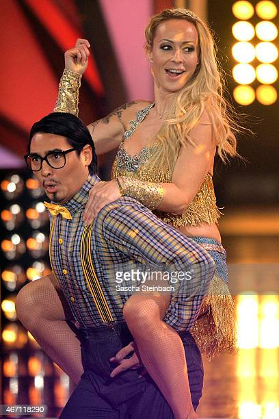 Defeated Erich Klann and Cora Schumacher enter the stage at the beginning of 2nd show of the television competition 'Let's Dance' on March 20 2015 in...