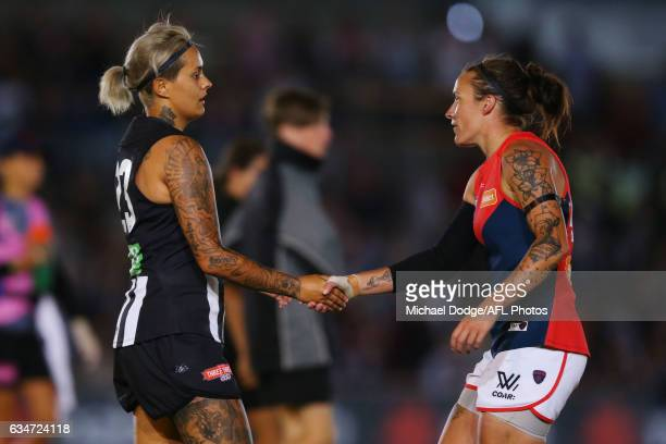 A defeated Moana Hope of the Magpies and Mia RaeClifford of the Demons shake hands after the final siren during the round two AFL Women's match...